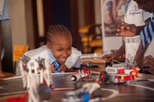 A student enjoying a session of building and operating a robot to complete a mission during one of the Travelling Telescope's Airbus Space Workshops. Credit: The Travelling Telescope.