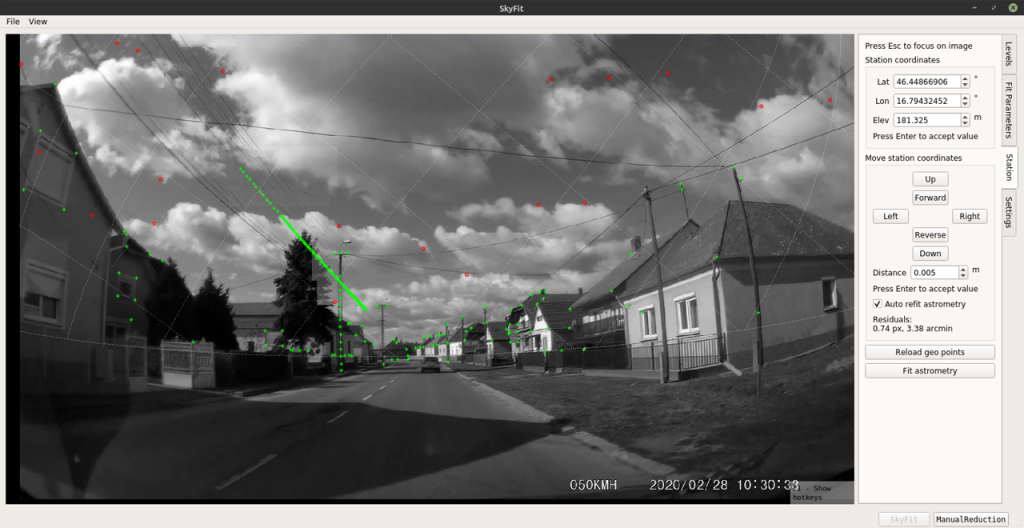 Screenshot of the SkyFit software using the heights of houses and lampposts for dashcam calibration. Credit: Denis Vida et al.