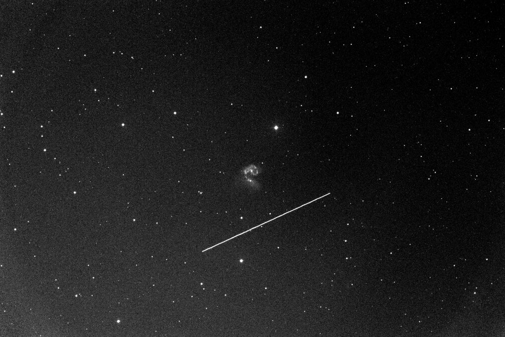 Credit: INOUE Takeshi. BepiColombo Earth Flyby. The central objects are Antennae Galaxies,(NGC 4038 / NGC 4039).